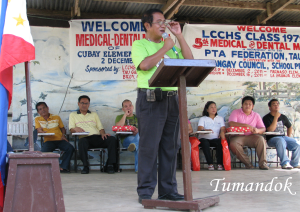 School principal giving message on Medical-dental mission